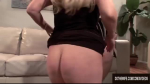 Mature blond lady is kneeling in front of her husband and sucking his hard dick